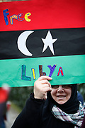 Anti Gaddafi protesters in support of a free Libya demonstrate outside the US Embassy in London. The demonstration was a combination of Libyans, and others who joined them in solidarity.