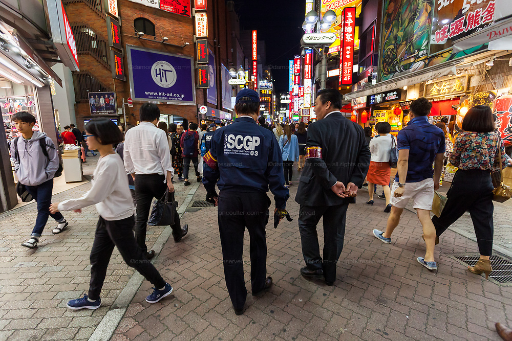 Members of the Shibuya Centre Gai Patrol group provide security in the Busy night life area of Centre Gai, Shibuya,  Tokyo, Japan. Friday May 12th 2017 Many popular areas for shoppers and tourists in Tokyo have their own dedicated crime prevention teams that patrol the streets. These are often formed from volunteers of local business association or are specific teams organised by the police service.
