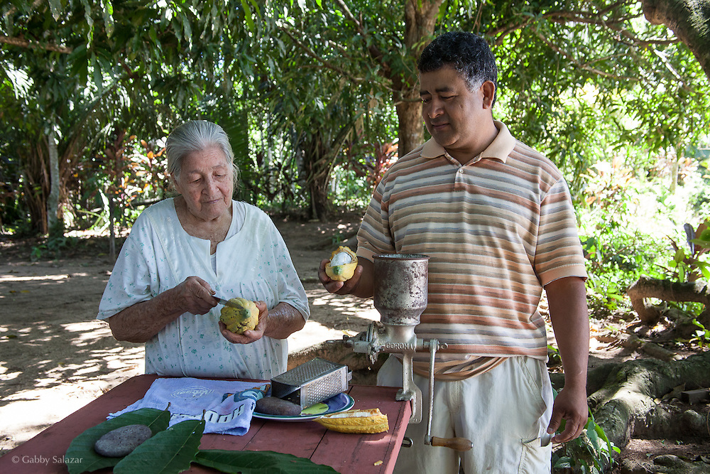 Cacao fruits are used by Percy Balarezo and his mother to make chocolate. Family and community-owned projects supported by Interoceanica SUR in the Tambopata buffer zone along the Tambopata River and in the ISUYAMA corridor near Puerto Maldonado, Peru.