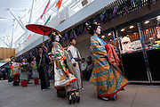Actors dressed as geisha and other characters from the Edo (samurai) Period to welcome visitors to Haneda International Airport, Tokyo, Japan. Tuesday May 3rd 2016. The Edo festival takes place over the three days of national holidays called Golden Week ( May 3rd to 5th) and features costume parades, music and stage shows along with other fun activities for visitors in and around the Edo themed shopping areas in the terminal building.