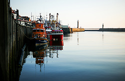 © Licensed to London News Pictures. <br /> 09/04/2017<br /> Whitby, UK. <br />  <br /> Whitby Lifeboat is moored in the harbour as the sun rises in Whitby in North Yorkshire. <br /> <br /> <br /> Photo credit: Ian Forsyth/LNP