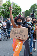 """People take part in a """"Black Trans Lives Matter"""" protest in Central London on Saturday, June 27, 2020.<br /> The Black Trans Lives Matter march was held to support and celebrate the Black transgender community and to protest against potential amendments to the gender recognition act. (Photo/ Vudi Xhymshiti)"""