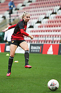 Portrait full length Manchester United midfielder Jackie Groden (14) warming up during the FA Women's Super League match between Manchester United Women and Manchester City Women at Leigh Sports Village, Leigh, United Kingdom on 14 November 2020.