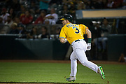Oakland Athletics center fielder Boog Powell (3) hits a single against the Los Angeles Angels at Oakland Coliseum in Oakland, California, on September 5, 2017. (Stan Olszewski/Special to S.F. Examiner)