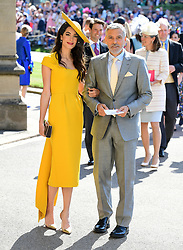 Amal and George Clooney arrive at St George's Chapel at Windsor Castle for the wedding of Meghan Markle and Prince Harry.