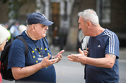 © Licensed to London News Pictures. 31/08/2019. London, UK. A Brexit supporter (right) and a Pro Eu demonstrator, remonstrate in  Westminster, central London ahead of a demonstration, part of a nationwide 'Stop The Coup' day of action against Boris Johnson's plans to suspend parliament. More than 80 demonstrations are planned across the UK in response to government plans to prorogue parliament. Photo credit: Ben Cawthra/LNP