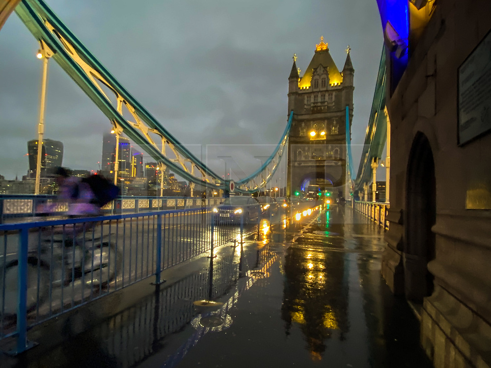 © Licensed to London News Pictures. 13/12/2020. London, UK. Reflection of Tower Bridge on a wet surface caused by rainfall on a wet day in the capital. Photo credit: Dinendra Haria/LNP