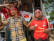 25 OCTOBER 2015 - SHWEPYITHAR, MYANMAR:  National League for Democracy activists in Shwepyithar, Myanmar, during a political rally and motorcade in the small town about 90 minutes from Yangon. Political parties are in fill campaign mode in Myanmar (Burma). National elections are scheduled for Sunday Nov. 8. The two principal parties are the National League for Democracy (NLD), the party of democracy icon and Nobel Peace Prize winner Aung San Suu Kyi, and the ruling Union Solidarity and Development Party (USDP), led by incumbent President Thein Sein. There are more than 30 parties campaigning for national and local offices.    PHOTO BY JACK KURTZ