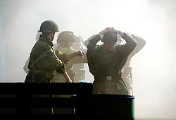 A Paratroopers from the 6th Airborne Division march German POWs away after a fire fight during a battle reenactment at Elsecar Heritage 1940's weekend - September 2010 <br />