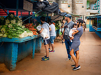 Couple with a baby at a food market in the Vedado area of Havana.