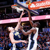 11 November 2017: Orlando Magic center Bismack Biyombo (11) goes for the layup against Denver Nuggets center Nikola Jokic (15) during the Denver Nuggets 125-107 victory over the Orlando Magic, at the Pepsi Center, Denver, Colorado, USA.