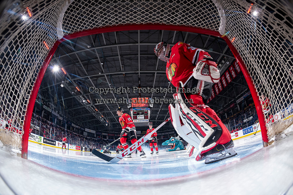 KELOWNA, BC - FEBRUARY 7: Joel Hofer #30 of the Portland Winterhawks scratches the crease at the start of the game against the Kelowna Rockets at Prospera Place on February 7, 2020 in Kelowna, Canada. Hofer was selected in the 2018 NHL entry draft by the ST. Louis Blues. (Photo by Marissa Baecker/Shoot the Breeze)
