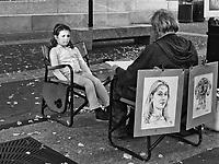Portrait artist Adam Sololowski at work in front of the Metropolitan Museum of Art