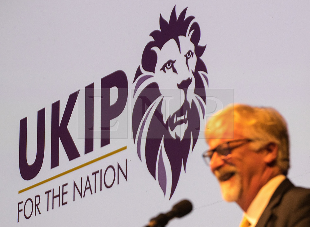 """© Licensed to London News Pictures . 29/09/2017 . Torquay , UK . Interim leader STEVE CROWTHER unveils the party's new logo , a lion that is reported to be very similar the the Premier League logo and tagline """" UKIP for the nation """" . The UK Independence Party Conference at the Riviera International Centre . UKIP is due to announce the winner of a leadership election which has the potential to split the party . Photo credit: Joel Goodman/LNP"""