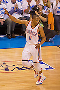 June 2, 2012; Oklahoma City, OK, USA; Oklahoma City Thunder guard Russell Westbrook (0) reacts to a play during a playoff game against the San Antonio Spurs at Chesapeake Energy Arena.  Thunder defeated the Spurs 109-103 Mandatory Credit: Beth Hall-US PRESSWIRE