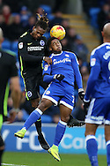 Gaetan Bong of Brighton is challenged in the air  by Kadeem Harris of Cardiff city. EFL Skybet championship match, Cardiff city v Brighton & Hove Albion at the Cardiff city stadium in Cardiff, South Wales on Saturday 3rd December 2016.<br /> pic by Andrew Orchard, Andrew Orchard sports photography.