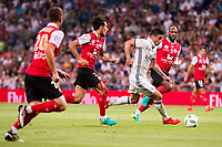 Real Madrid's player James Rodriguez and Stade de Reims's player Bouhours and Da Cruz during the XXXVII Santiago Bernabeu Trophy in Madrid. August 16, Spain. 2016. (ALTERPHOTOS/BorjaB.Hojas)