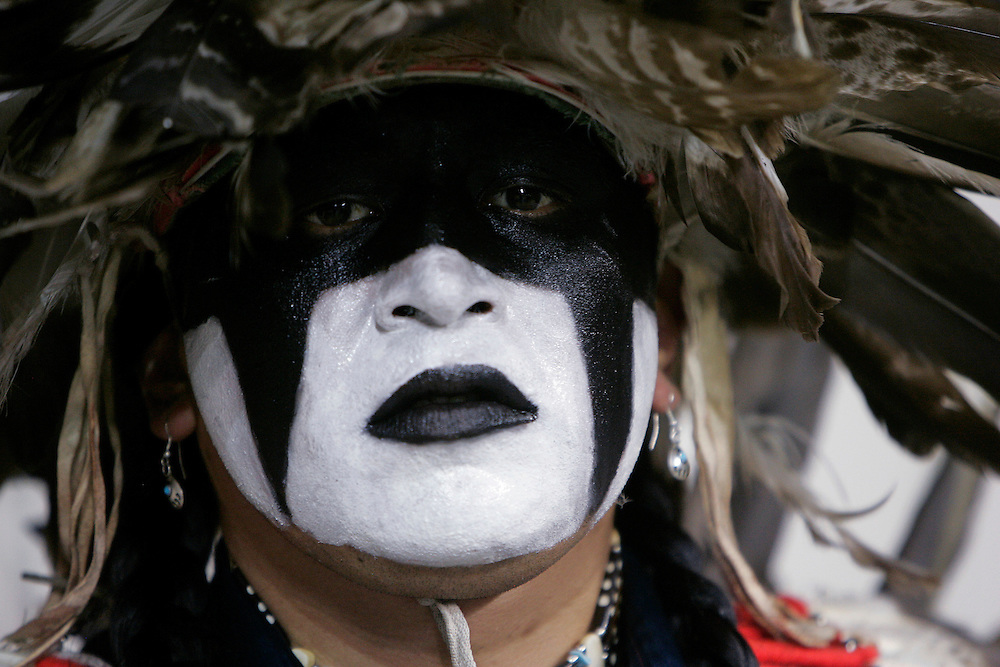 """Gerard Moses Goudy of the Yakima tribe in Washington state watches the Denver March Pow Wow in Denver, Colorado March 23, 2007. Goudy represented the """"Wounded Warriors"""" non-profit group working to restore Natives cultural identity. The March Pow Wow brings thousands of Native American Indians together in a celebration of their culture. REUTERS/Rick Wilking (UNITED STATES)"""
