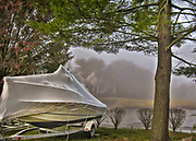 Shrink wrapped power boat in the marsh in Rye, New york