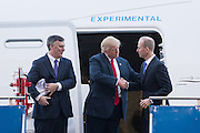 U.S. President Donald Trump shakes hands with Boeing CEO Dennis Muilenburg, right, as Boeing Commercial Aircraft CEO Kevin McAllister, left, looks on after touring the new Boeing 787-10 Dreamliner aircraft at the Boeing factory February 17, 2016 in North Charleston, SC. Trump is at the factory for the rollout of the new aircraft.