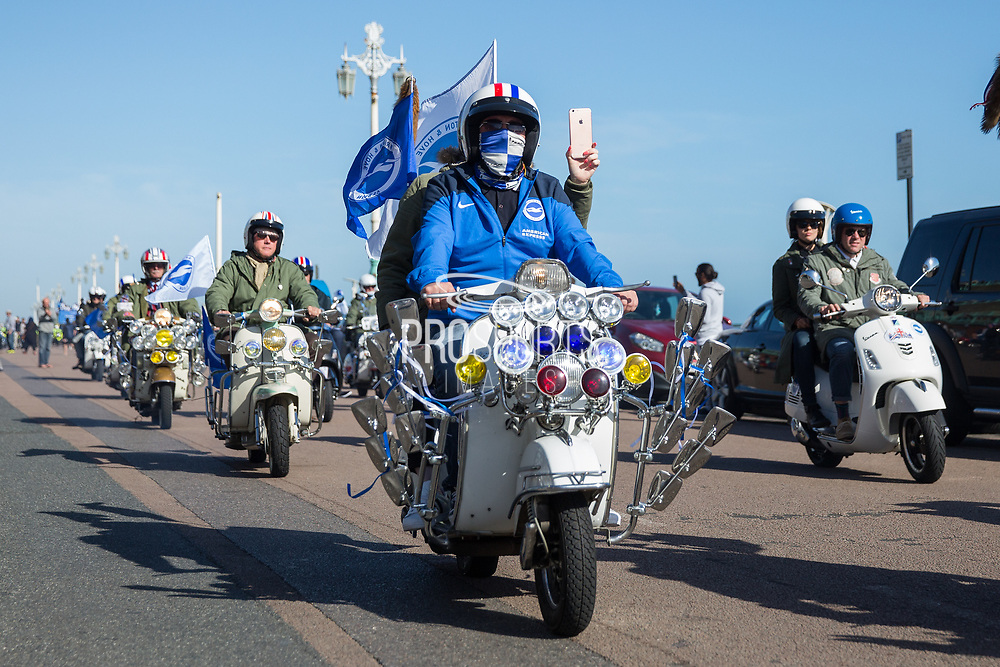 Mod scooterist in Brighton and Hove colours during the Brighton & Hove Albion Football Club Promotion Parade at Brighton Seafront, Brighton, East Sussex. United Kingdom on 14 May 2017. Photo by Ellie Hoad.
