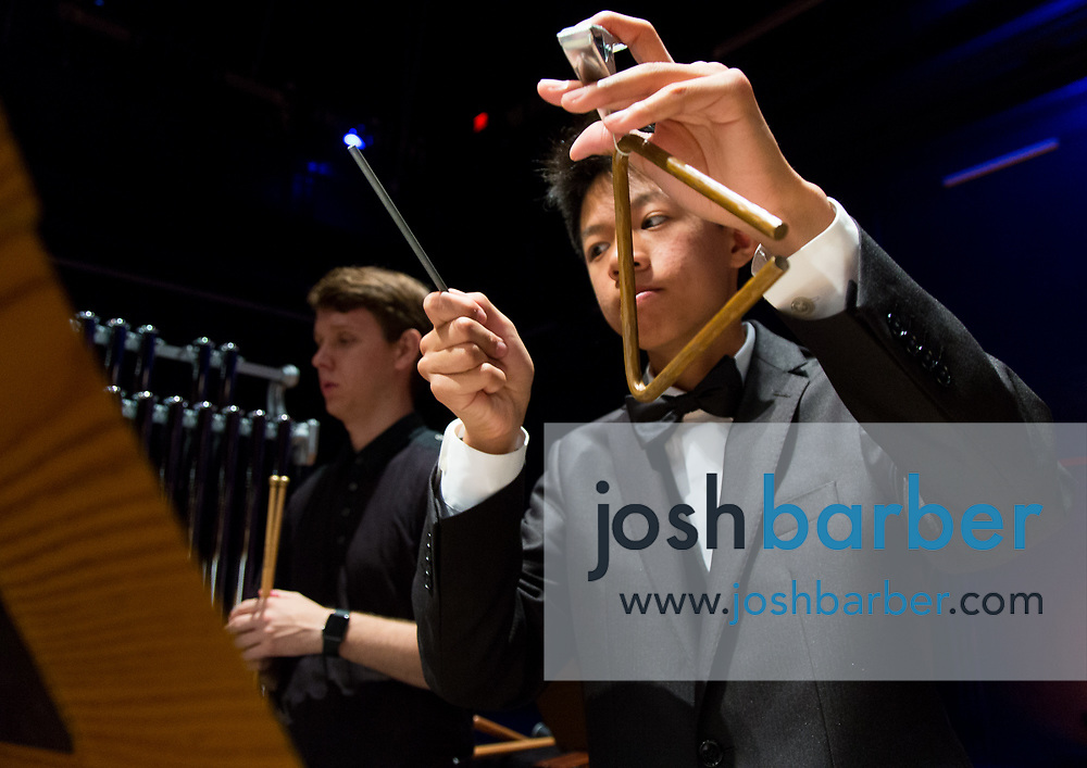 Orange County Youth Symphonic Orchestra percussionist  Jay Ni plays the triangle during a dress rehearsal for a joint performance with the Beckman High School String Orchestra at Chapman University's Julianne Argyros Orchestra Hall on Sunday, May 14, 2017 in Orange, Calif. (Photo by Josh Barber, Orange County Register Contributing Photographer)