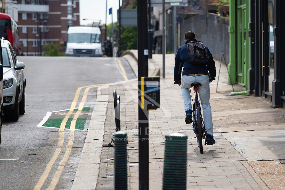 Local residents and businesses are mystified by a very short cycle lane on Chamberlayne Road in Kensal Rise, North West London. The 10 metre long green-surfaced lane is placed just cards from the intersection with Mortimer and Harvist Roads, outside Parkheath Estate Agents. London, August 29 2018.