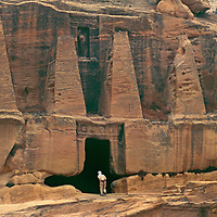 Petra, Jordan. Visitor at the Obelisk Tomb, carved into sandstone cliff by ancient Nabateans.