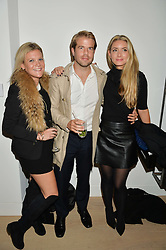 Left to right, OLIVIA PERRY, NICK HOUSE and LUCINDA EDWARDS at an evening of Fashion, Art & design hosted by Ralph Lauren and Phillips at the new Phillips Gallery, 50 Berkeley Square, London on 22nd October 2014.