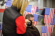 04 FEBRUARY 2011 - PHOENIX, AZ: DALE SPARKS, a homeless veteran of the US Army gets his haircut at the Arizona StandDown Friday. The Arizona StandDown is an annual three day event that brings together the Valley's homeless and at-risk military veterans, connecting them with services ranging from: VA HealthCare, mental health services, clothing, meals, emergency shelter, transitional and permanent housing, ID/ drivers license's, court services and Legal Aide, showers, haircuts and myriad other services and resources. Arizona StandDown is held annually at the Veterans Memorial Coliseum at the Arizona State Fairgrounds in Phoenix on Super Bowl weekend.    Photo by Jack Kurtz