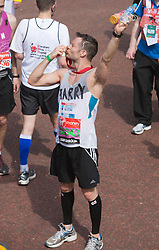 © Licensed to London News Pictures. 21/04/2013. London, England. Picture: Harry Judd of McFly. Celebrity Runners and Fun Runners finish the Virgin London Marathon 2013 race in the Mall, London. Many wore black ribbons to pay their respect for those who died or were injured in the Boston Marathon. Photo credit: Bettina Strenske/LNP
