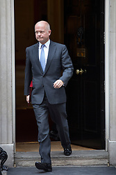 © licensed to London News Pictures. London, UK 28/08/2013. Foreign Secretary William Hague leaving No10 on Downing Street, London on Wednesday, 28 August 2013 after attending a meeting of the National Security Council regarding the Syrian crisis. Photo credit: Tolga Akmen/LNP