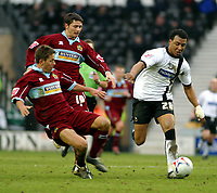 Photo: Dave Linney.<br />Derby County v Burnley. Coca Cola Championship. 11/03/2006Derby's .Giles Barnes(R) pushes away the challenge of  Jon Harley