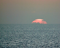 Sunset over the Bay of Bengal from the deck of the MV World Odyssey. Image taken with a Nikon N1V3 camera and 70-300 mm VR lens.