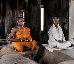 Aug. 2, 2013 - Senior and young monk meditating in temple in Angkor Wat, Siem Reap, Cambodia (Credit Image: © Gary  Latham/Cultura/ZUMAPRESS.com)