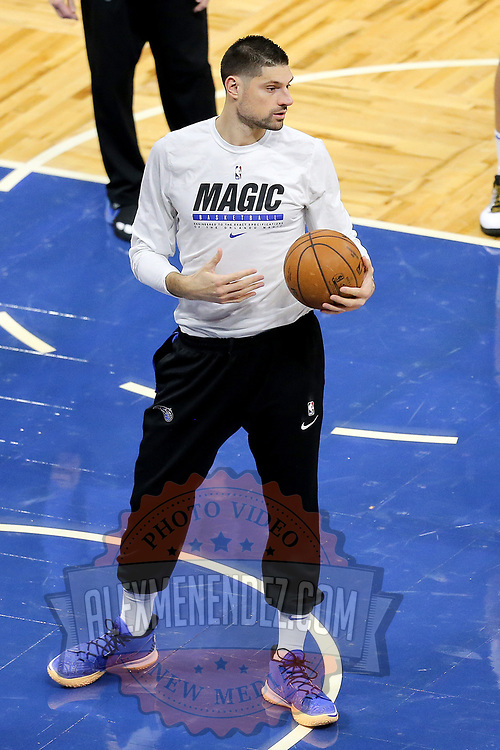 ORLANDO, FL - FEBRUARY 17:   Nikola Vucevic #9 of the Orlando Magic warms up against the New York Knicks at Amway Center on February 17, 2021 in Orlando, Florida. NOTE TO USER: User expressly acknowledges and agrees that, by downloading and or using this photograph, User is consenting to the terms and conditions of the Getty Images License Agreement. (Photo by Alex Menendez/Getty Images)*** Local Caption *** Nikola Vucevic