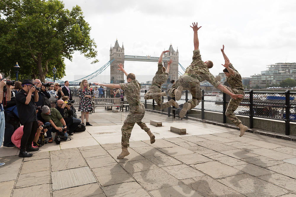 © Licensed to London News Pictures. 07/09/2017. LONDON, UK.  Rosie Kay (blue, red and white dress front) and photographers attend a photocall where the British Army in conjunction with the Rosie Kay Dance Company perform an extract of 5 SOLDIERS: The Body is the Frontline, at Tower Wharf in the Tower of London to celebrate the work's return to London.  Photo credit: Vickie Flores/LNP