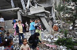 Palestinian children are seen playing around the remnants of their home, which was destroyed in an Israeli airstrike, Beit Hanoun, Gaza Strip, Palestinian Territories, Nov. 14, 2006. According to Human Rights Watch, since September 2005, Israel has fired about 15,000 rounds at Gaza while Palestinian militants have fired around 1,700 back.