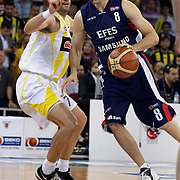 Fenerbahce Ulker's Omer ONAN (L) and Efes Pilsen's Igor RAKOCEVIC (R) during their Turkish Basketball league Play Off Final Sixth Leg match Fenerbahce Ulker between Efes Pilsen at the Abdi Ipekci Arena in Istanbul Turkey on Wednesday 02 June 2010. Photo by Aykut AKICI/TURKPIX