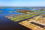Nederland, Groningen, Oldambt, 01-05-2013; Blauwestad, nieuw aangelegd woongebied inclusief recreatiegebied. Het Oldambtmeer dient ook als waterberging. In de voorgrond, nog onbebouwd, de wijk 'het Dorp' en op het tweede plan 'De Wei' met kavels voor zelfbouw. Het project Blauwe Stad was oorspronkelijk bedoeld om de economisch achtergebleven regio van Noordoost Groningen een impuls te geven. De economische en huizen crisis gooit echter roet in het eten.<br /> <br /> Blauwestad (Blue City) newly constructed residential area, including recreational lake. The Oldambt lake also serves as water storage. In the foreground the still undeveloped area 'the Village', on the second plan 'De Wei' (Meadow) with plots suited for 'DIY' buidling of houses. The Blue City project is meant to give a boost to the  economically backward region of northeast Groningen.<br /> luchtfoto (toeslag); aerial photo (additional fee required);<br /> foto Siebe Swart / photo Siebe Swart