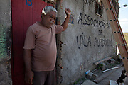 Augusto Periera outside his home before it is demolished. His house is one of the last standing of the original homes, is demolished today. Vila Autodromo favela, in the west zone of Rio, is in direct site of the Rio 2016 Olympic park. There has been an ongoing struggle between residents and the City Government of Eduardo Paes. After a long battle, 20 families who held on were allowed to stay, on the provision that they moved into houses constructed by the state, in the same style as the public housing programme.