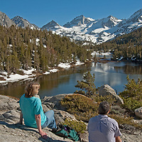 Hikers relax beside Marsh Lake, in Little Lakes Valley, at the head of Rock Creek Canyon in California's eastern Sierra Nevada.