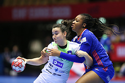 HERNING, DENMARK - DECEMBER 6: Tjasa Stanko is stopped by Pauletta Foppa during the EHF Euro 2020 Group A match between Slovenia and France in Jyske Bank Boxen, Herning, Denmark on December 6, 2020. Photo Credit: Allan Jensen/EVENTMEDIA.