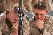 U.S. Marines attend a memorial service at COP Coutu for Lance Corporal Daniel Raney and Lance Corporal Timothy Serwinowski. Both Marines were killed in Marjah.