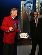28 August 2006: Phil Anschutz (l) is presented with his Hall of Fame jacket, plaque, and ring by HOF president Will Lunn during his induction. The National Soccer Hall of Fame Induction Ceremony was held at the National Soccer Hall of Fame in Oneonta, New York.