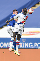 LEICESTER, ENGLAND - JULY 04: Cheikhou Kouyate of Crystal Palace in an aerial challenge with Jamie Vardy of Leicester City during the Premier League match between Leicester City and Crystal Palace at The King Power Stadium on July 4, 2020 in Leicester, United Kingdom. Football Stadiums around Europe remain empty due to the Coronavirus Pandemic as Government social distancing laws prohibit fans inside venues resulting in all fixtures being played behind closed doors. (Photo by MB Media)