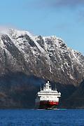 MS Richard With sailing into Herøyfjord, Norway | Hurtigruteskipet MS Richard With seiler inn i Herøyfjord, Norge. Skorpesundet i bakgrunnen.