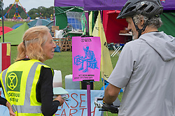 © Licensed to London News Pictures 27/08/2021. <br /> Blaclheath, UK. Extinction Rebellion has set up camp for two weeks on Blackheath common while they protest in Central London. About 150 activists are living in tents relaxing and socialising together. Photo credit:Grant Falvey/LNP