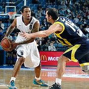 Efes Pilsen's Lawrence ROBERTS (L) during their Turkish Basketball league derby match Efes Pilsen between Fenerbahce Ulker at the Sinan Erdem Arena in Istanbul Turkey on Sunday 24 April 2011. Photo by TURKPIX