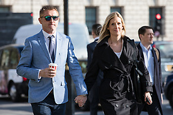 © Licensed to London News Pictures. 06/04/2017. London, UK. JON PLATT (L), with his wife, arrives at the Supreme Court in London. Platt took his daughter out of school for seven days during term time, and was subsequently prosecuted when he refused to pay the £60 penalty charge. The High Court ruled in Platt's favour concluding that he did not have to pay the fine, but Isle of Wight Council appealed the decision with the support of the Department for Education. The ruling is due today. Photo credit: Rob Pinney/LNP